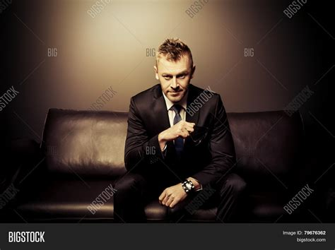 couch man portrait handsome mature man image photo bigstock