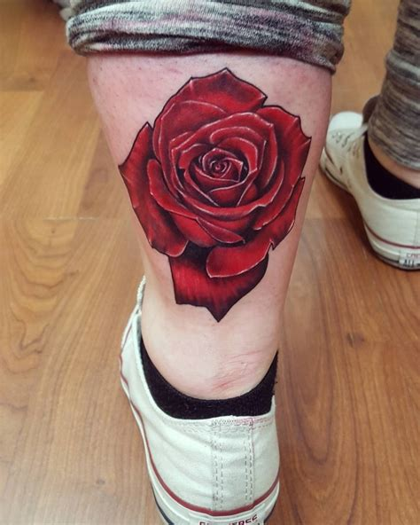 rose tattoo on leg black ink pencil on leg