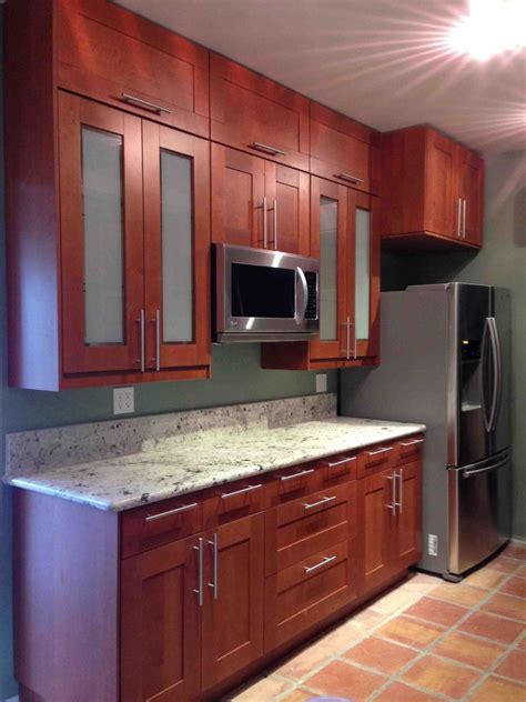 beautiful grimslov medium brown kitchen cabinets
