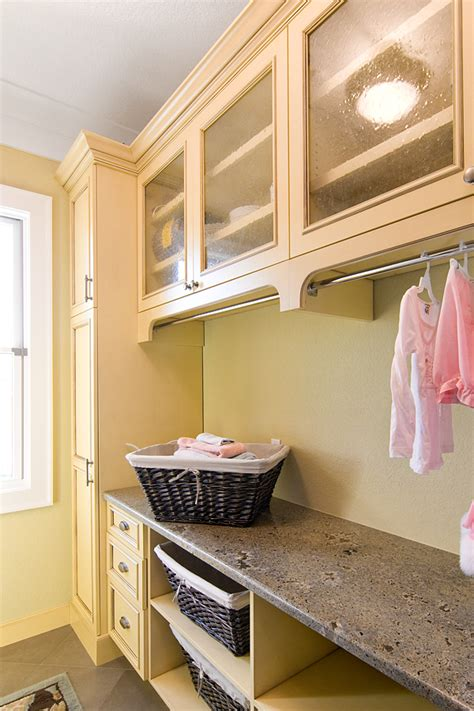 Laundry Room I Love The Subtle Under Cabinet Hanging Hanging Laundry Room Cabinets