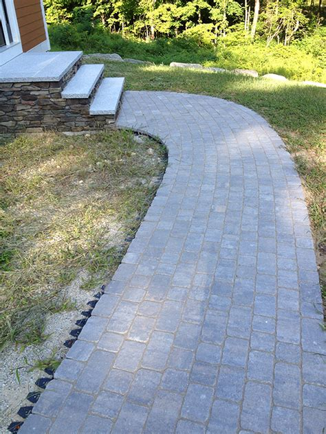 distinctive stone paver or brick walkways and driveways for homes