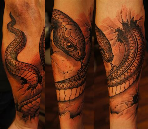 snake arm tattoo 63 snake tattoos on sleeve