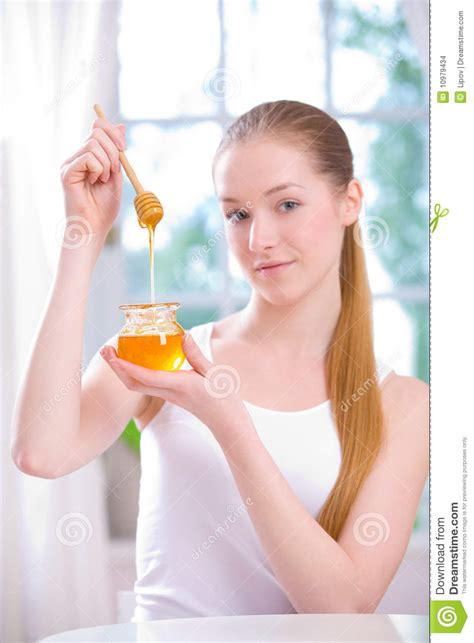 young girl honey pot girl with jar of honey stock images image 10979434