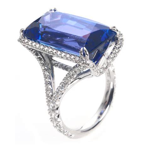 emerald cut tanzanite ring with diamond halo   wixon jewelers