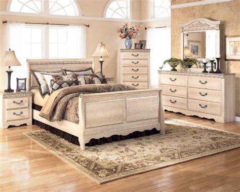 silverglade bedroom set ashley silverglade sleigh bedroom set in light wood
