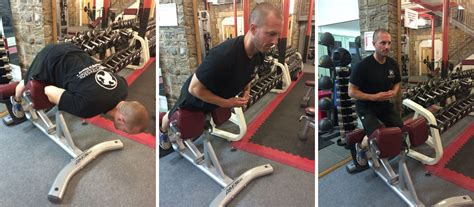 glute ham raise on hyperextension bench a balancing act avoiding lower back pain