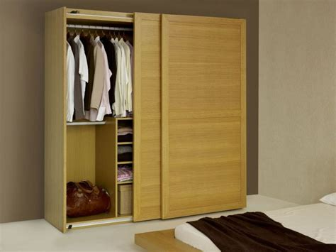 Free Standing Cedar Closet by Brown Wooden Free Standing Wardrobe With Sliding Door And Racks Also White Cloth Hook On The