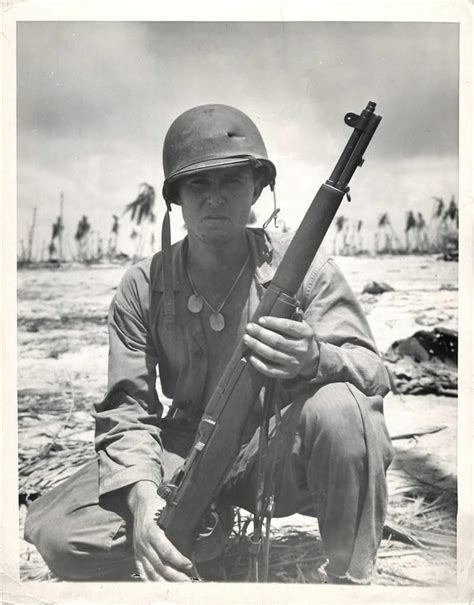 learn to pack like the marines travelpro 174 luggage blog wwii u s soldiers poses with his m1 garand rifle on