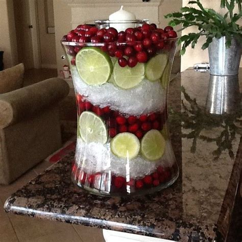 christmas decorating with hurricane ls christmas centerpiece cut limes cranberries and plastic