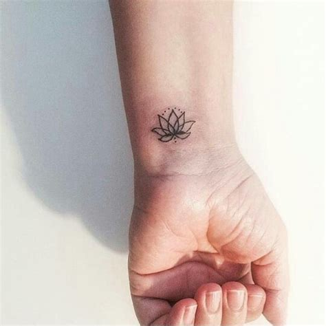 tattoo finger lotus lotus flower tattoo pinteres