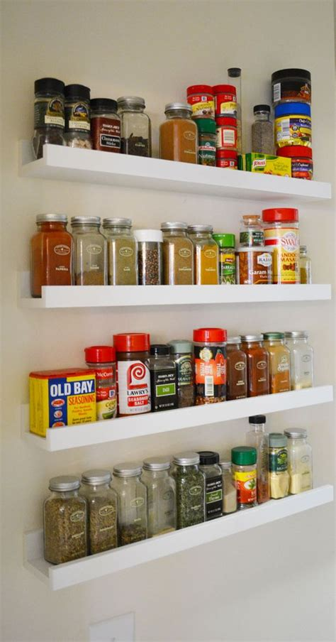 ikea spice rack and mini jars for inside of pantry closet 29 ideas to use ikea ribba ledges around the house digsdigs