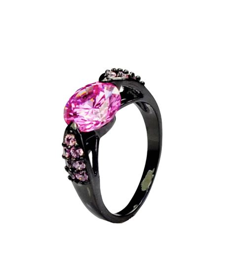 black gold pink sapphire ring