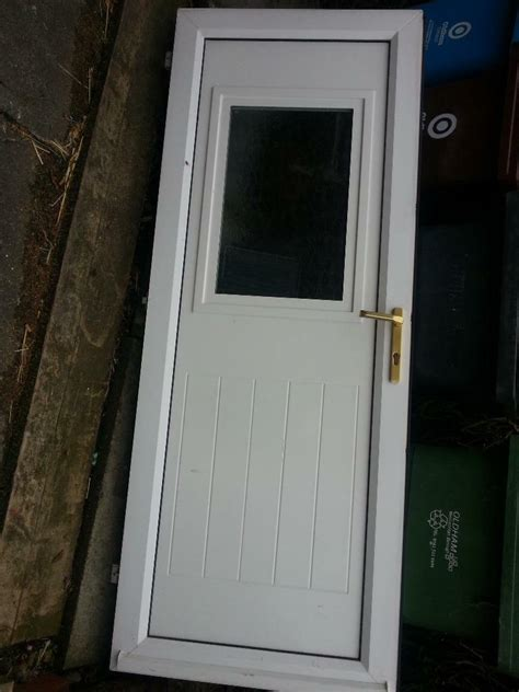 white pvc exterior door and frame with key 77 quot x 31 75