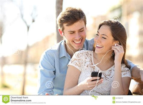 For Couples On Phone Listening To The From A Smart Phone Stock