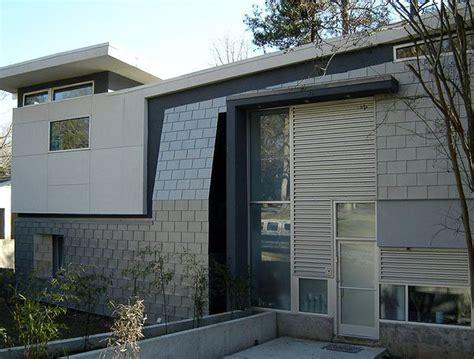 panel siding for houses lewitt residence georgia rheinzink prepatina blue gray zinc sinusoidal corrugated