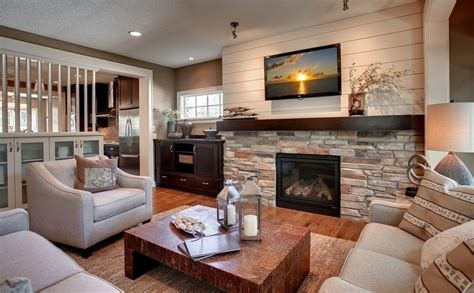 decorating with family photos family room decorating with stone wood burning fireplace