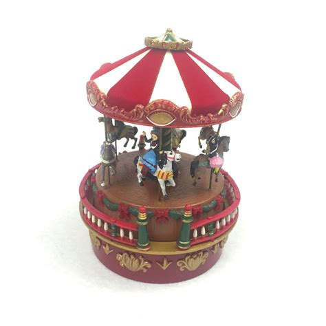 xmas music boxes on ebaymusical bell on ebay bnib mr box carousel plays the melody jingle bells ebay