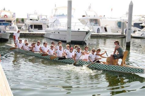 dragon boat racing dubai festival city dubai s festival marina brings the community together