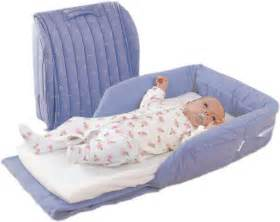 Snuggle nest creates a safe place for baby to sleep between mom and