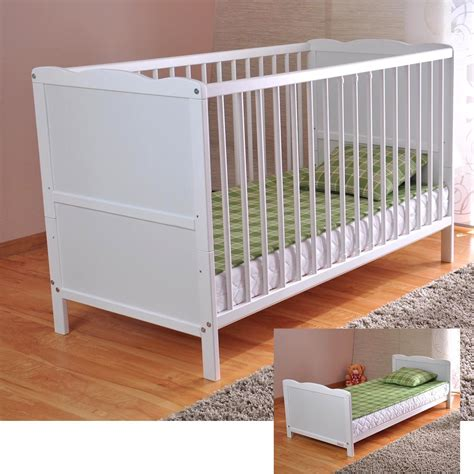white baby beds 3 position white baby cot bed deluxe foam mattress converts into a junior bed ebay