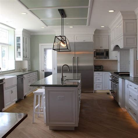 light grey kitchen cabinets  dark countertops ski