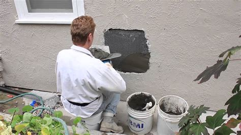 poured cement wall repair and stucco home improvement repair a hole in a stucco plastered wall plumbing repairs
