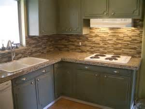kitchen granite tile countertop and glass backsplash