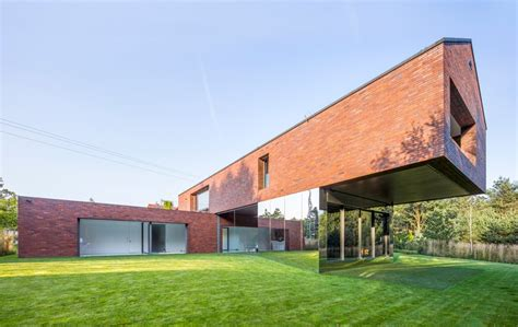 house poland kwk promes blends living and nature with garden house in poland