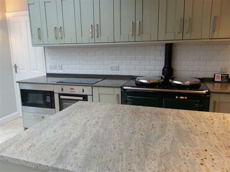 Kitchen With Stove In Island by Kashmir White Granite Island Altair Quartz Worktops