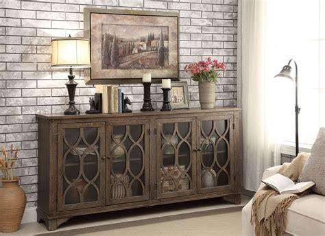 media credenza furniture cayhill distressed brown 4 door media credenza from coast