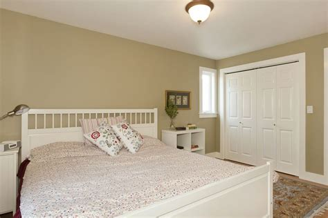 Cottage Master Bedrooms by Cottage Master Bedroom With Carpet Hardwood Floors In