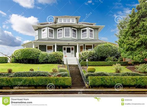 Add Curb Appeal - large luxury green craftsman classic american house exterior stock photography image 32325432
