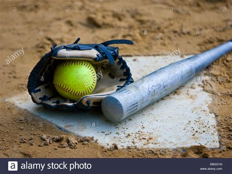 softball images softball glove and bat at home plate stock photo royalty