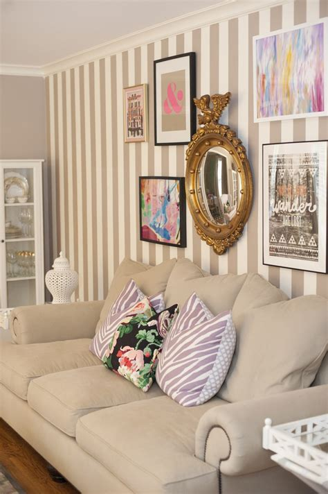 striped living room walls epley home tour living room striped walls gallery wall beige sofa