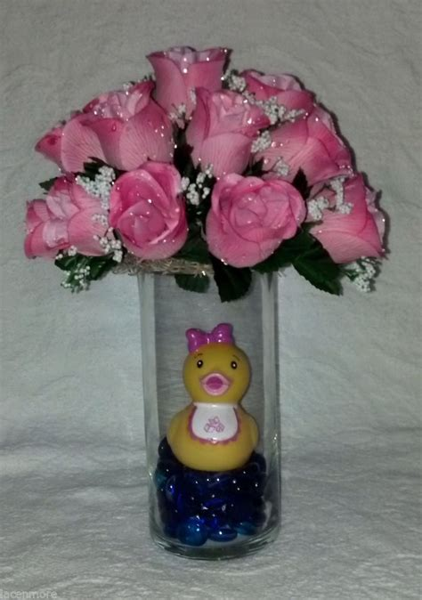 rubber duck centerpiece for a baby featuring pink