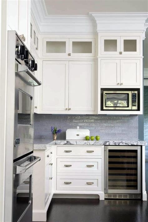 White Kitchen with Blue Backsplash and Roman Shade