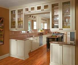 Kitchen Cabinets Photos off white cabinets in casual kitchen by kitchen craft cabinetry