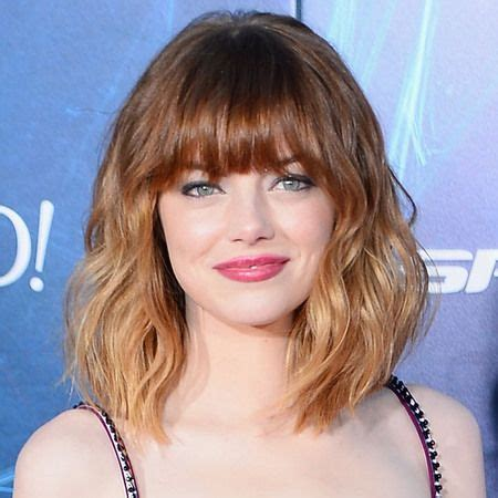 bob hairstyles explained emma stone works the tousled bob with her new fringe