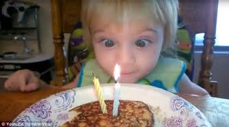 boy tries and fails to blow out his birthday cake candles with his eyes daily mail online