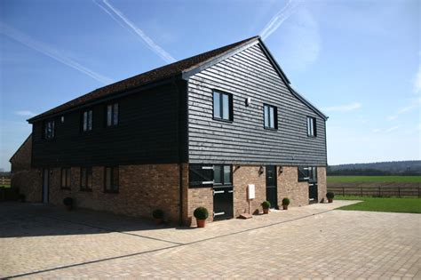 barn converted to the contemporary house with a pool barns converted into homes with modern brick wall and
