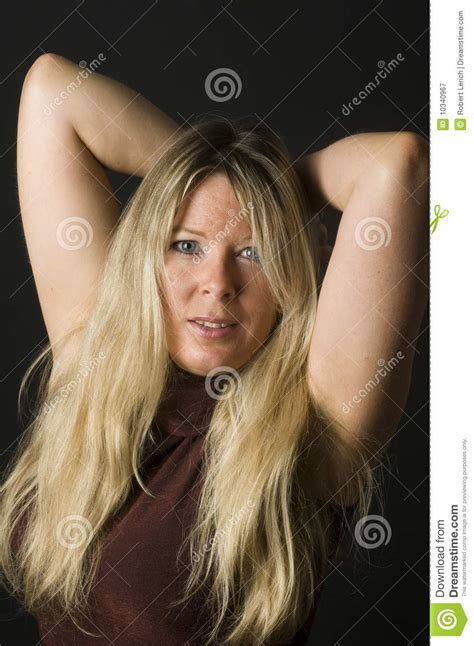 middle age women with blue hair sexy woman blond hair royalty free stock photography