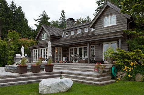 modern log cabin exterior traditional with log exterior glass doors