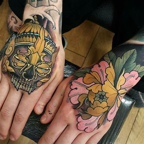 215 tattoo on hand meaning the 25 best hand tattoos for men ideas on pinterest