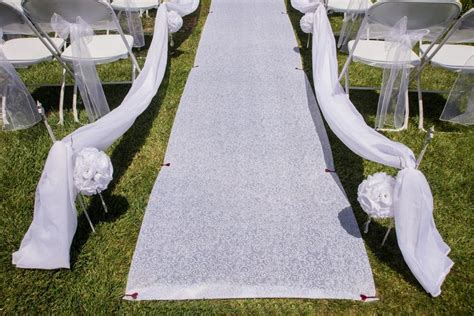 Wedding Aisle Runner For Grass by How To Secure A Wedding Aisle Runner On The Grass For An