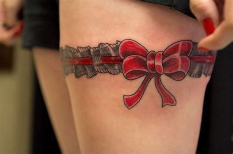 red bow garter tattoo on upper leg female tattoofemale