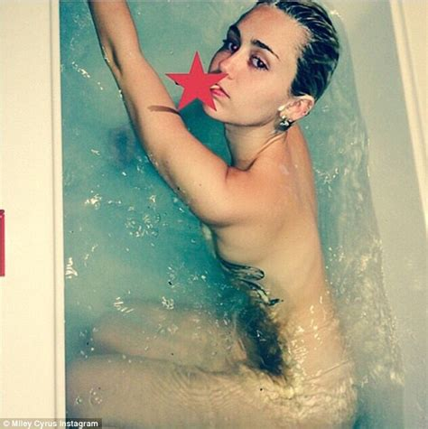 miley cyrus in bathtub miley cyrus goes topless on instagram after posing naked