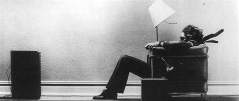 Sitting In Chair In Front Of Speaker blown away iconic photos