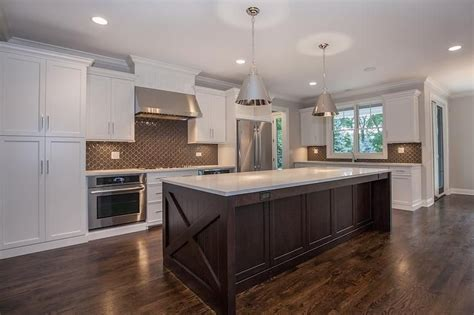 brown cabinets with white countertops white and brown kitchen features white shaker cabinets