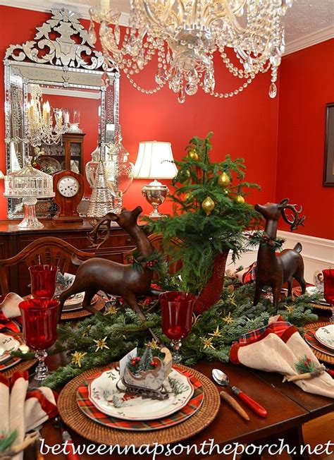 black and red christmas tablescapes table setting tablescape with plaid plates and a greenery centerpiece