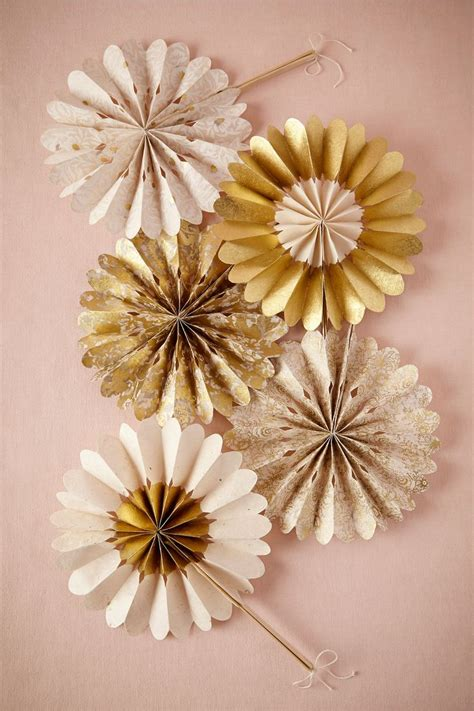 How To Make Crinkle Paper Flowers - celebration crinkle fans in gold from bhldn wedding
